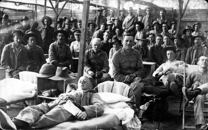 Hospital in Heliopolis. Frank sitting in front, hands crossed.