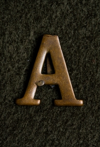 Brass 'A' ANZAC badge issued after the war.